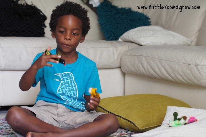 boy playing with finger puppets