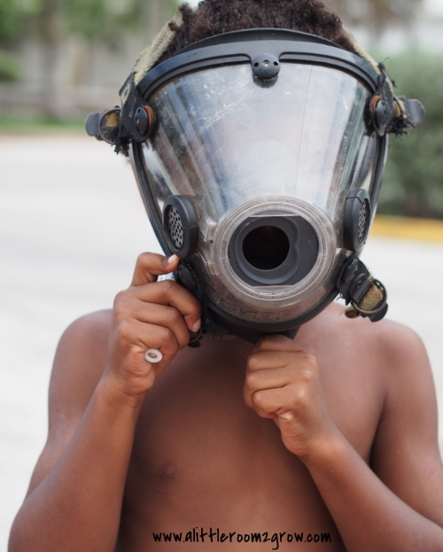 boy wears fireman mask