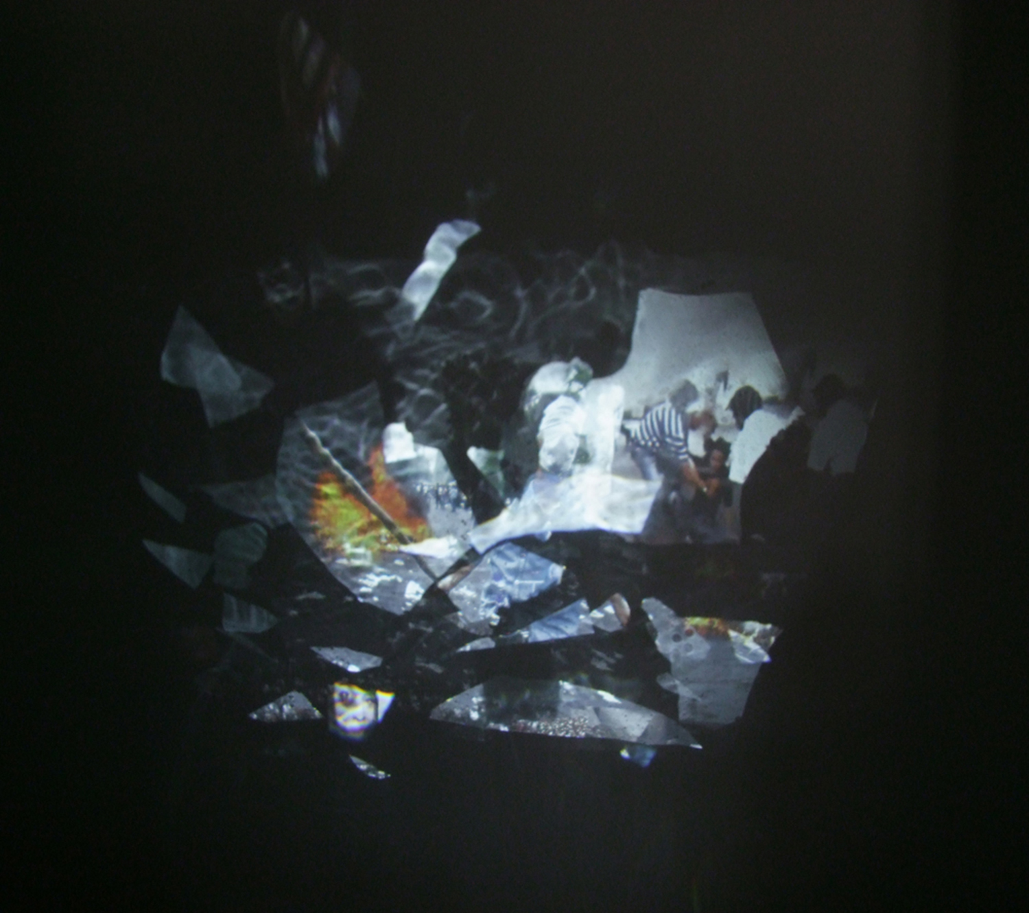 """""""Boundaries"""" detail of the projection reflecting off the mirror and onto the wall, 2011."""