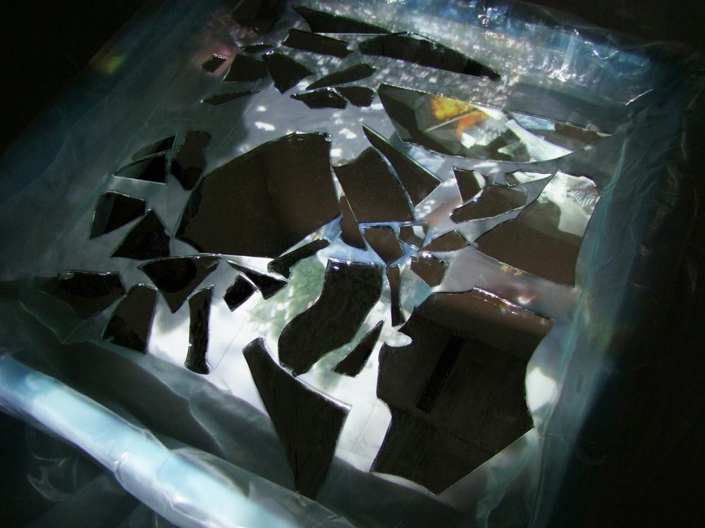 """""""Boundaries"""" detail of mirror fragments in water, 2011."""