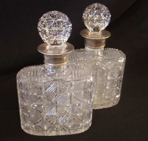 pair-of-matching-antique-edwardian-cut-glass-and-silver-topped-whisky-decanters-23905.jpg