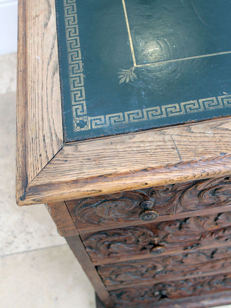 Antique carved chest with greek key leather top