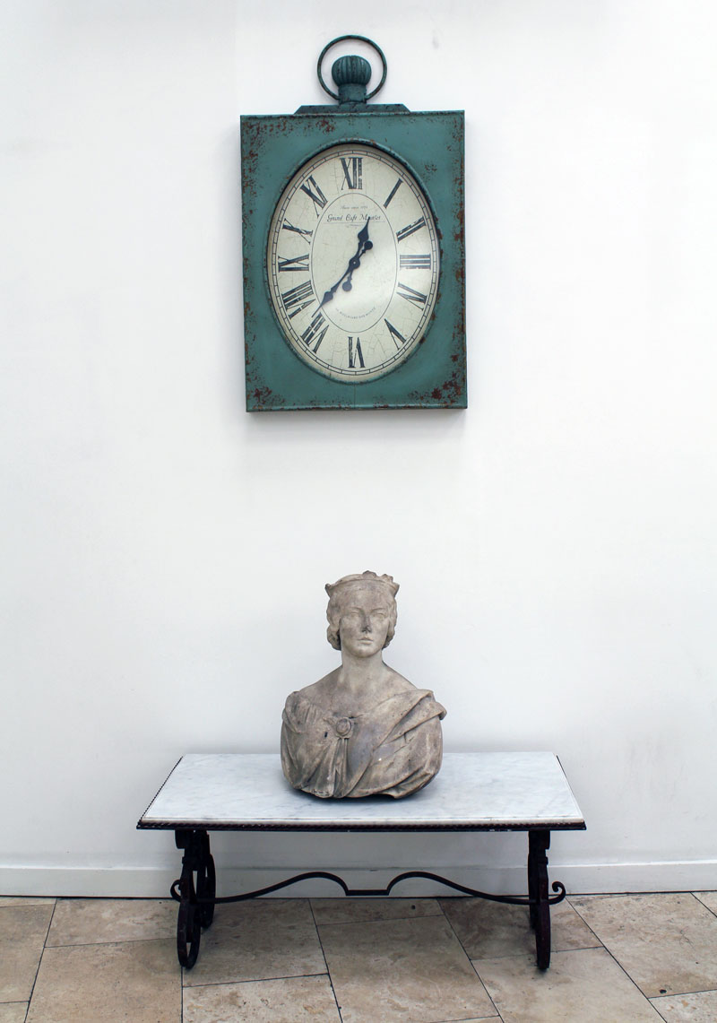 antique bust and clock