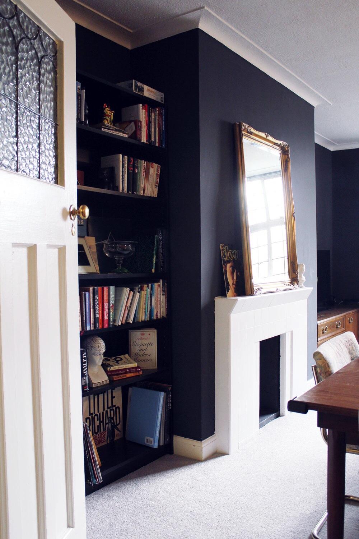 dark living room bookshelves