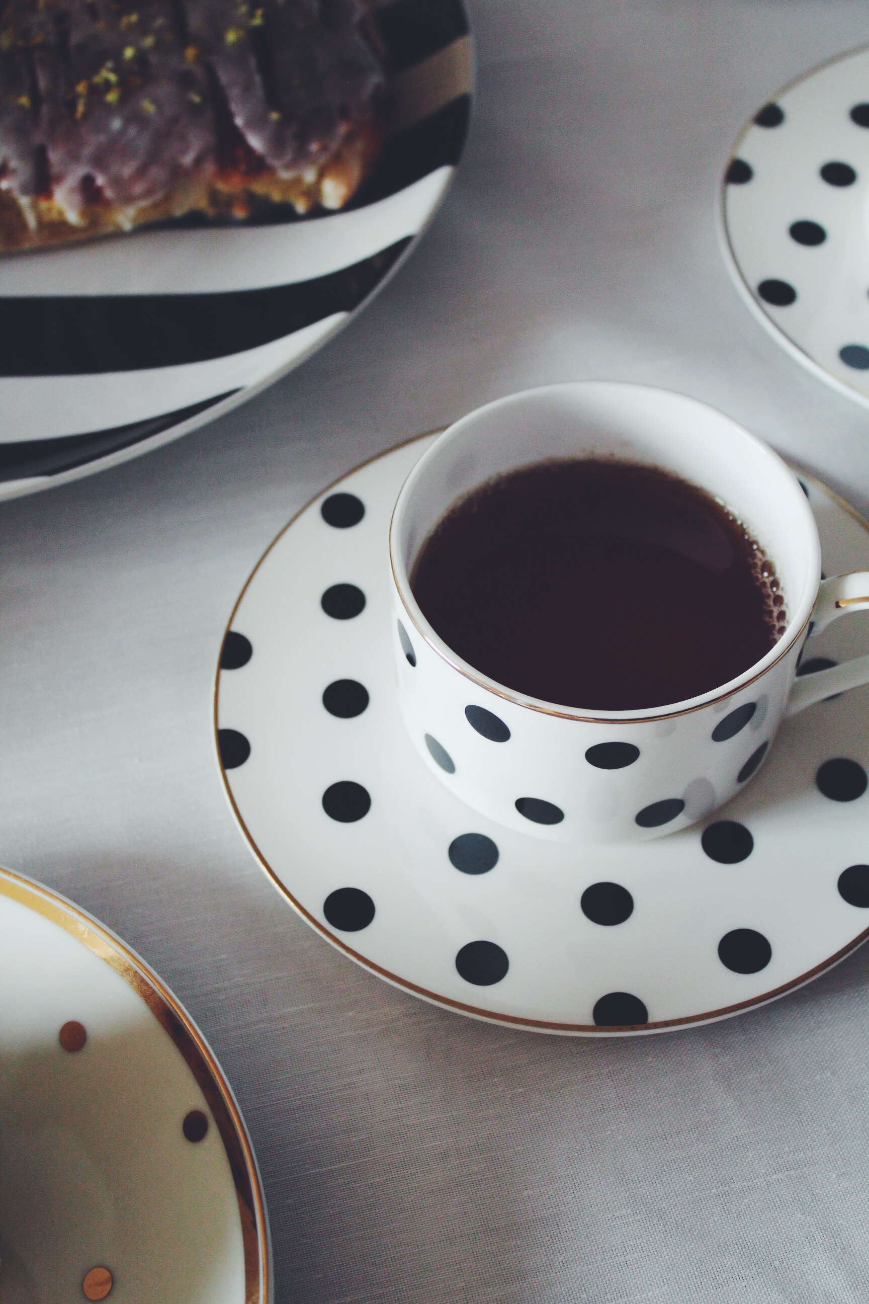 black white gold teacup and saucer