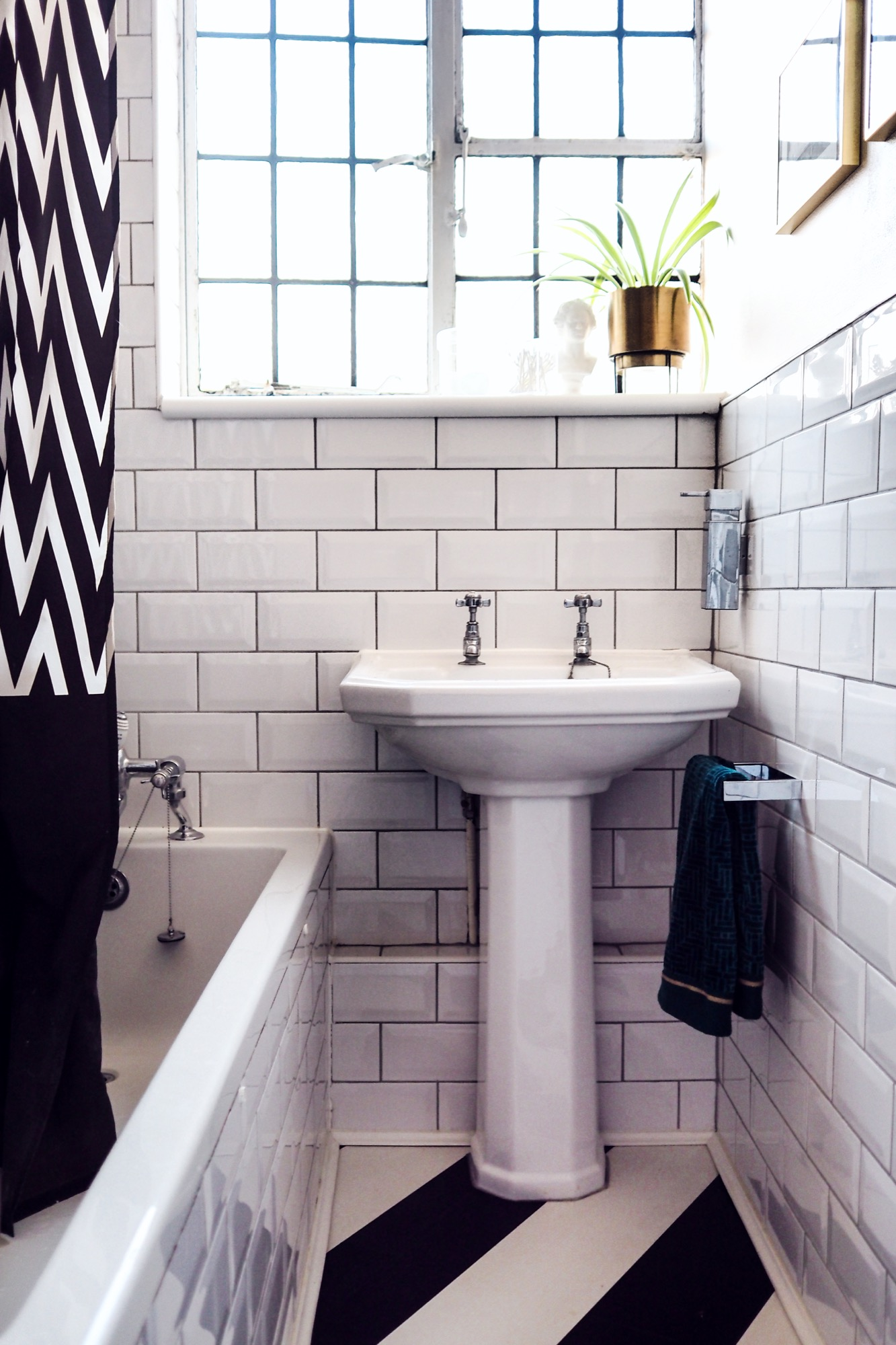 Really pleased with how this blush pink and green bathroom makeover turned out! It works so well with the white subway tiles and dark grout. The brass accents just finish it off!