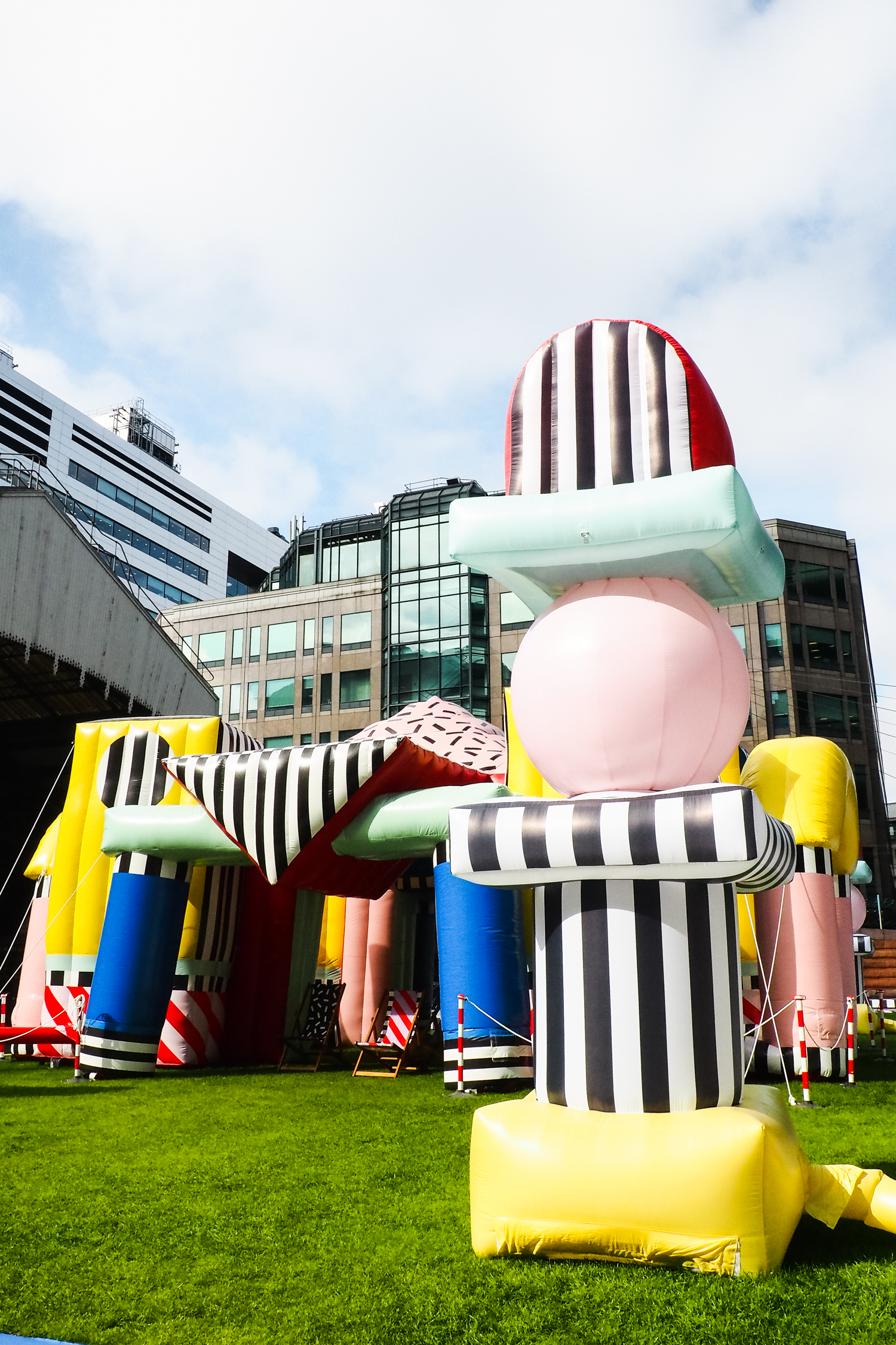 1. villa walala - an inflatable dream land juxtaposed with surrounding city buildings by Camille Walala