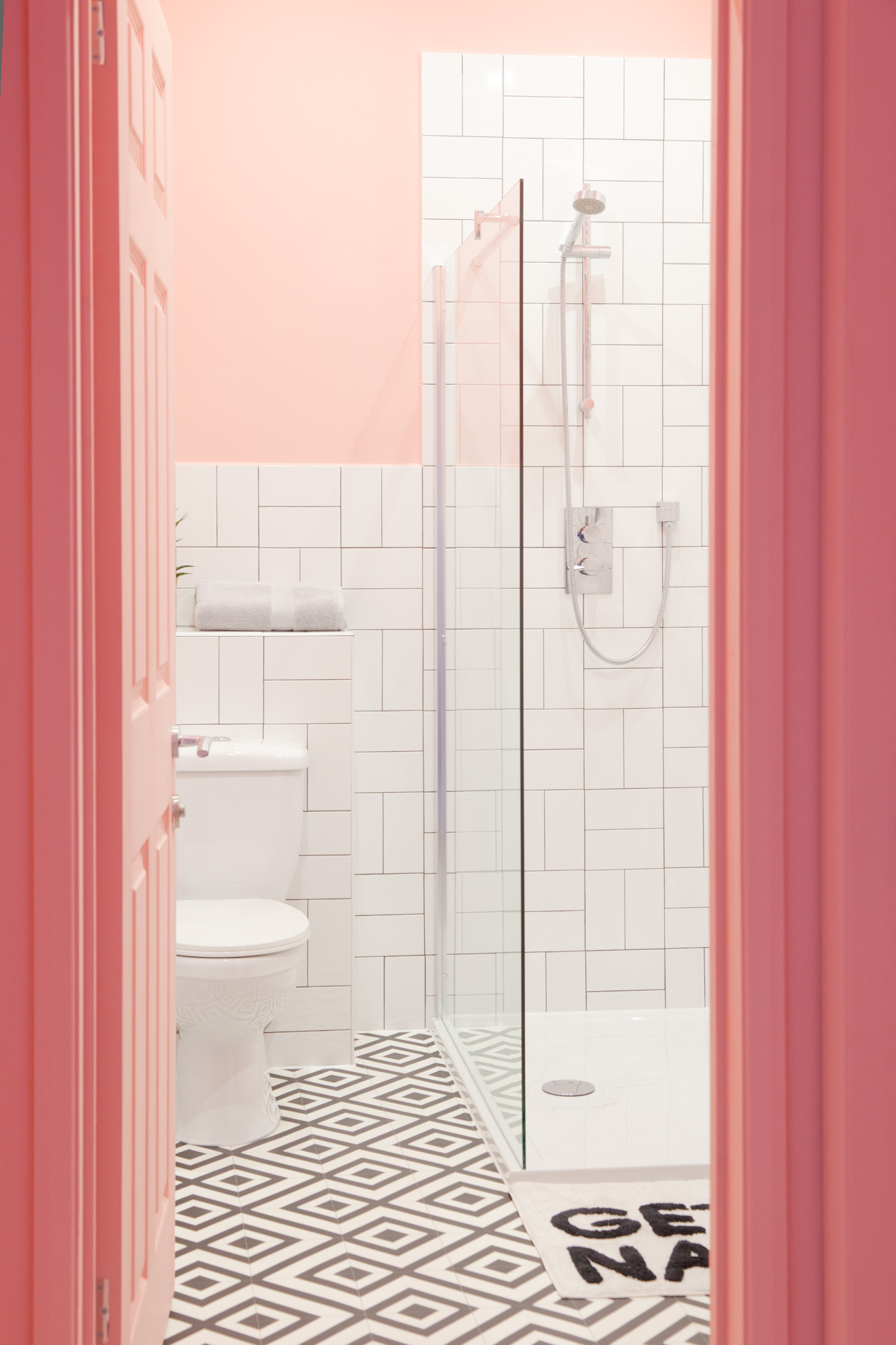 This pink bathroom with gold accents was a big hit! The simple white subway tiles are laid in an interesting pattern to create a fresh new look.