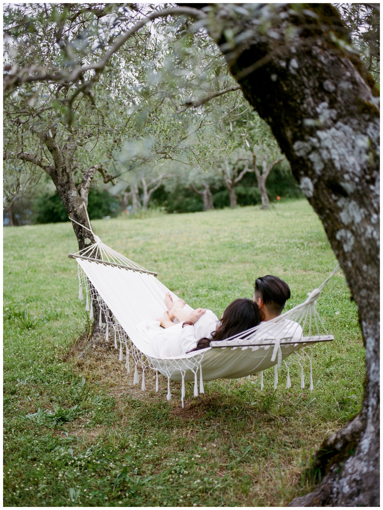 Spring Engagement at Villa Montanare in Cortona Tuscany, Italy by fine art wedding photographer Lissa Ryan Photography couple in hammock in an olive grove