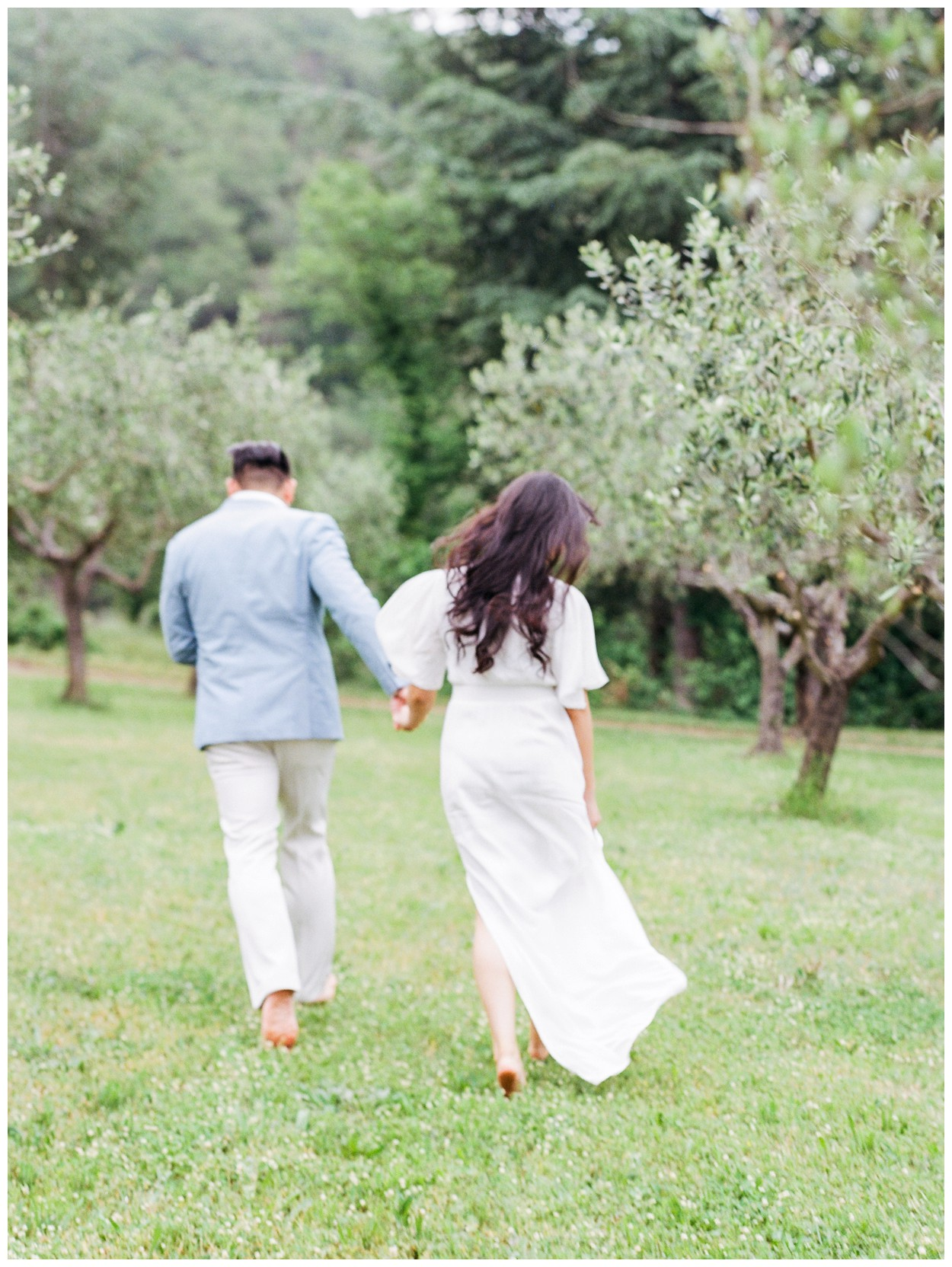 Spring Engagement at Villa Montanare in Cortona Tuscany, Italy by fine art wedding photographer Lissa Ryan Photography couple running in an olive grove