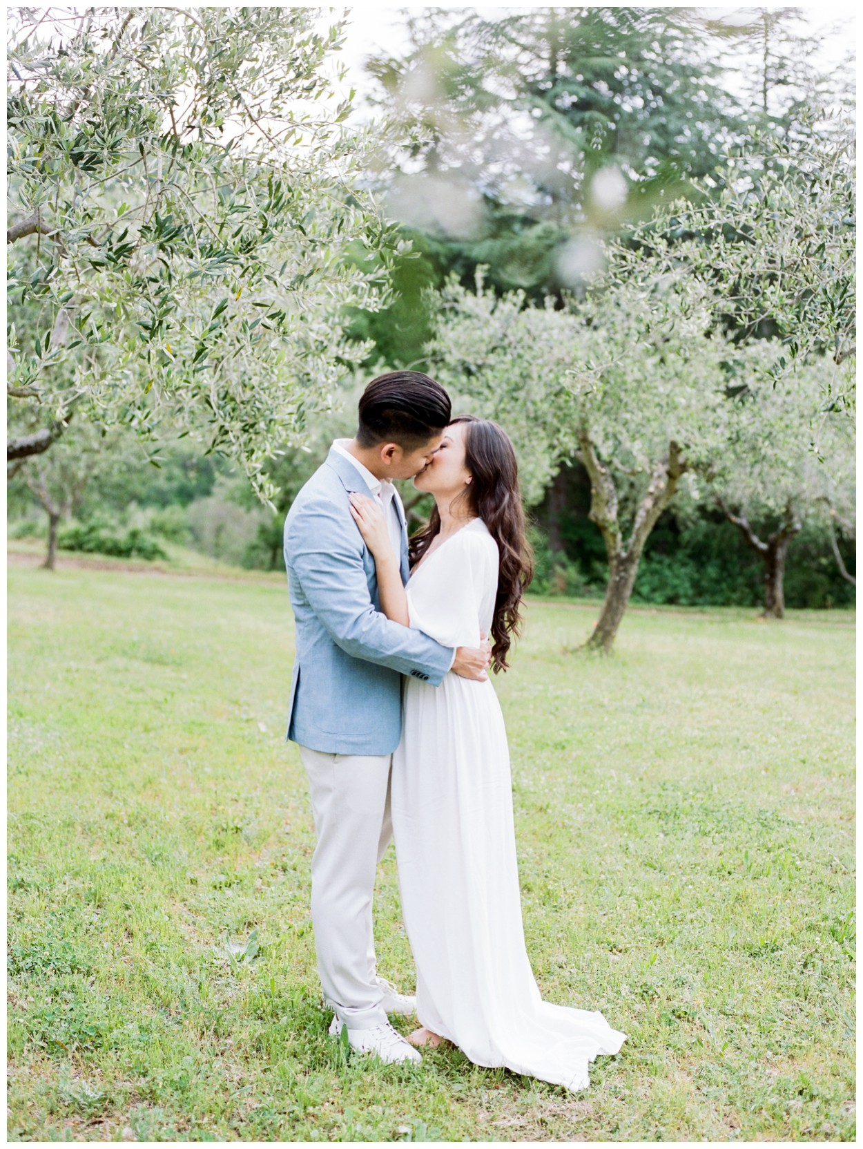 Spring Engagement at Villa Montanare in Cortona Tuscany, Italy by fine art wedding photographer Lissa Ryan Photography couple in an olive grove