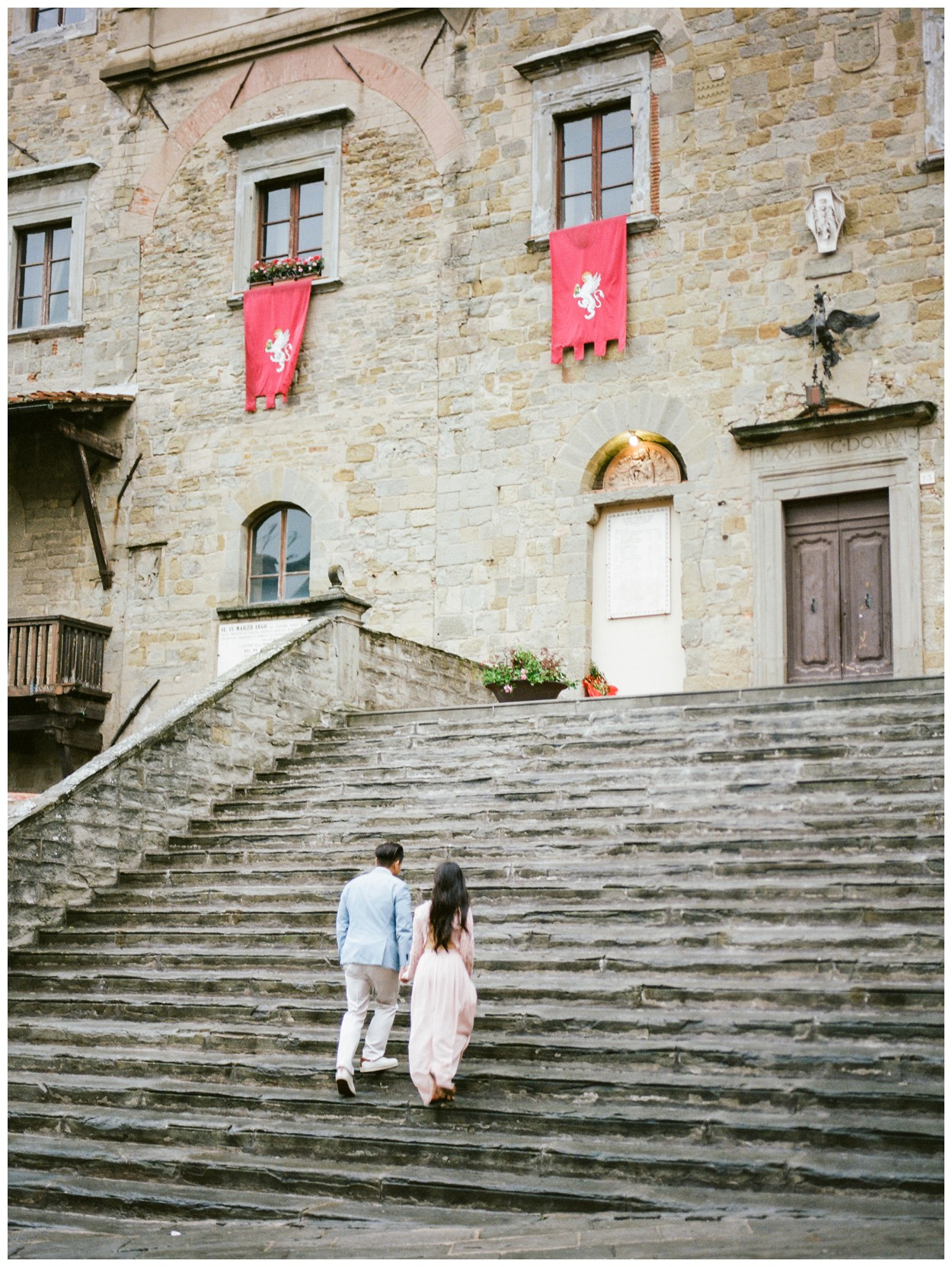 Spring Engagement at Villa Montanare in Cortona Tuscany, Italy by fine art wedding photographer Lissa Ryan Photography couple at Cortona Town Hall