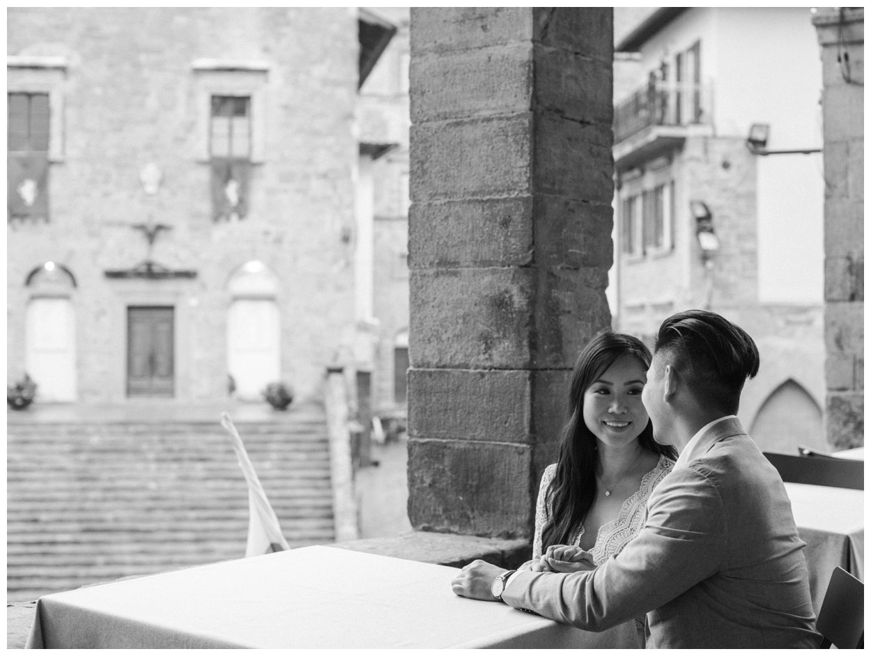 Spring Engagement at Villa Montanare in Cortona Tuscany, Italy by fine art wedding photographer Lissa Ryan Photography couple in Cortona overlooking the main square