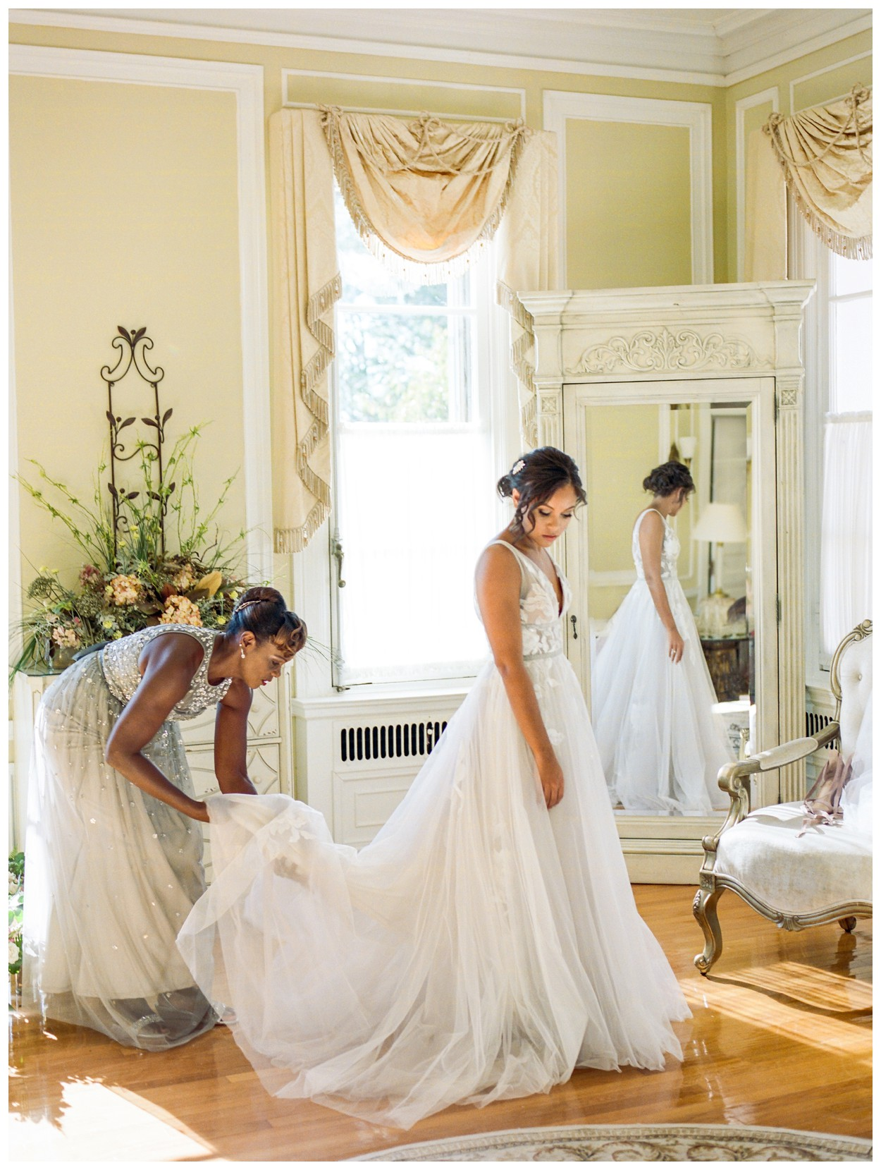 Sun drenched fall wedding in shades of pink at Oxon Hill Manor in Maryland beautiful bride getting ready with her mom by fine art wedding photographer Lissa Ryan Photography