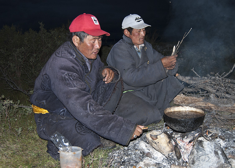 Mongolian guides, tending campfire brewing tea copy copy.jpg