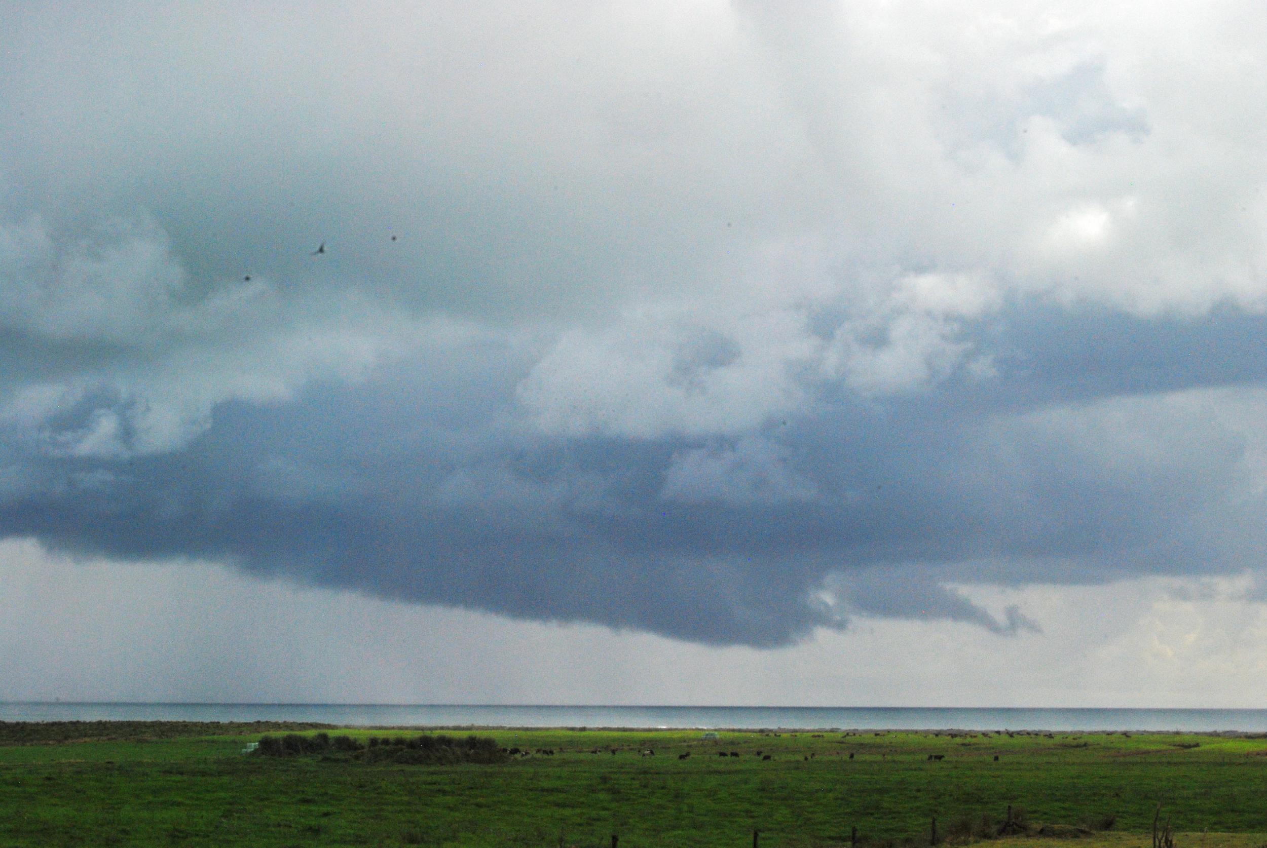 RAIN CLOUDS OVER THE SEA