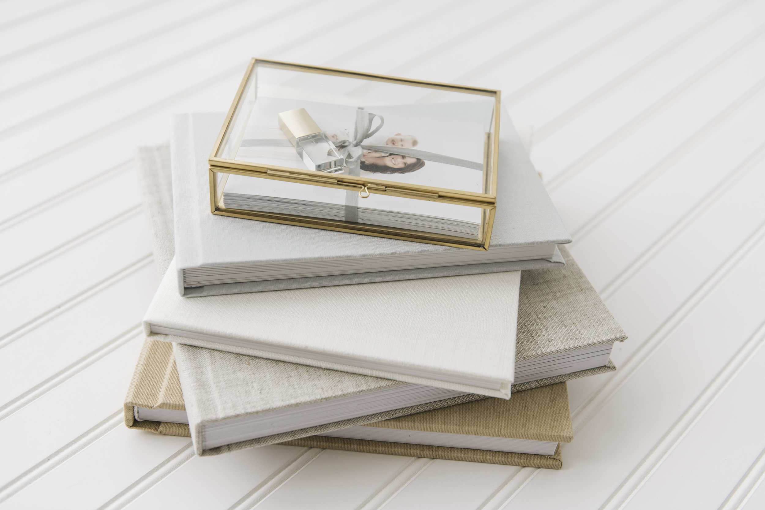 gold glass box with photo proofs and glass usb drive