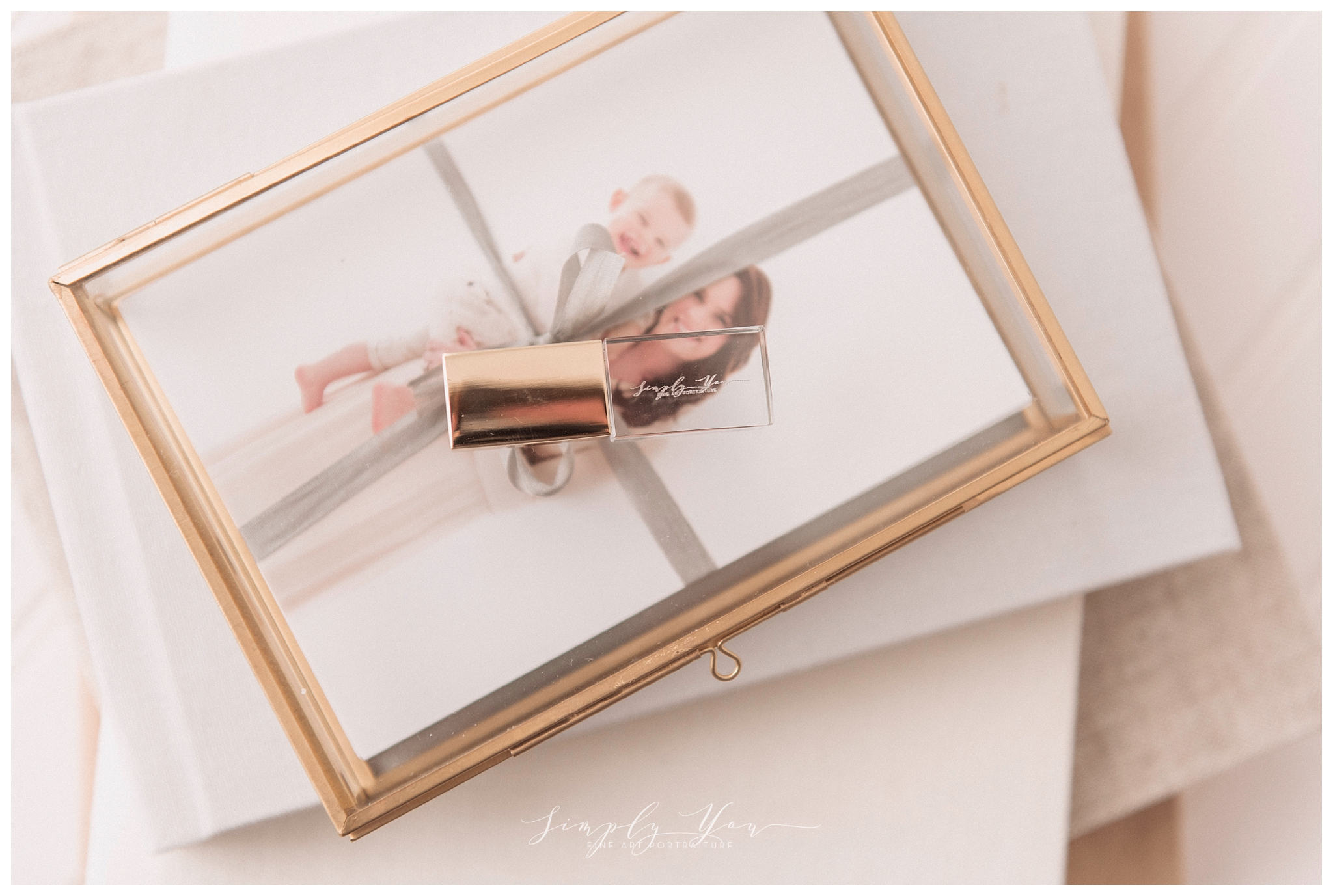 glass box with glass usb drive and photo proofs