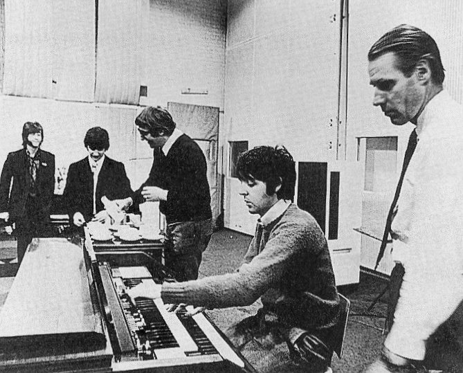 Producer George Martin with The Beatles