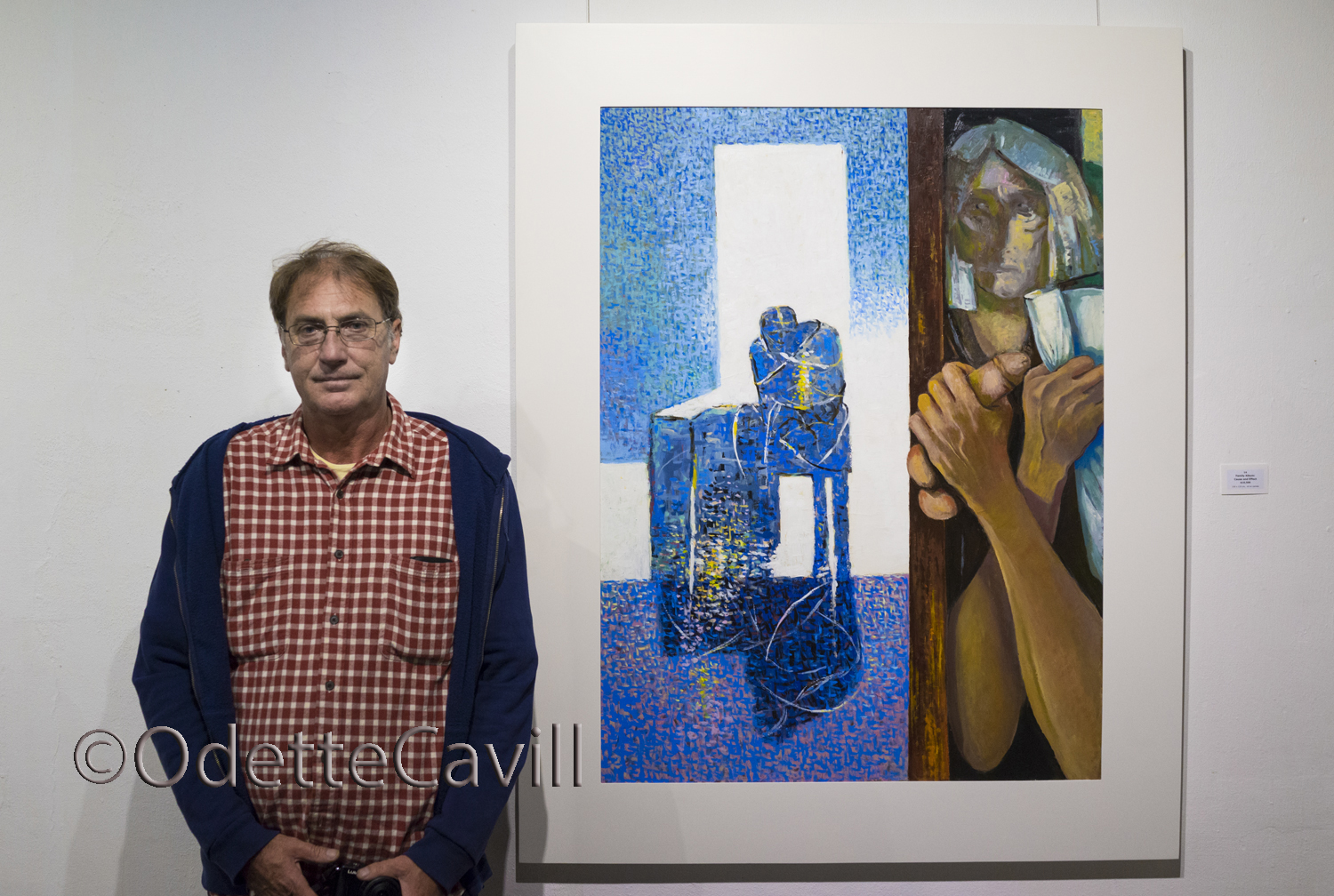 A fellow photographer Gerard stands next to one of Laszlo's works.