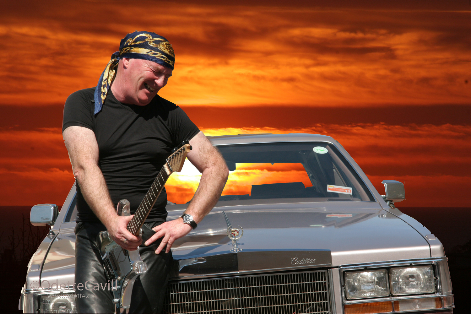 Michael Powers  (Singer/Guitarist/Fremantle Identity)  This image was made combining a sunset taken from my porch and Michael in front of this Cadillac. It was one of my first attempt at photoshop. Michael used this image for promotional work.