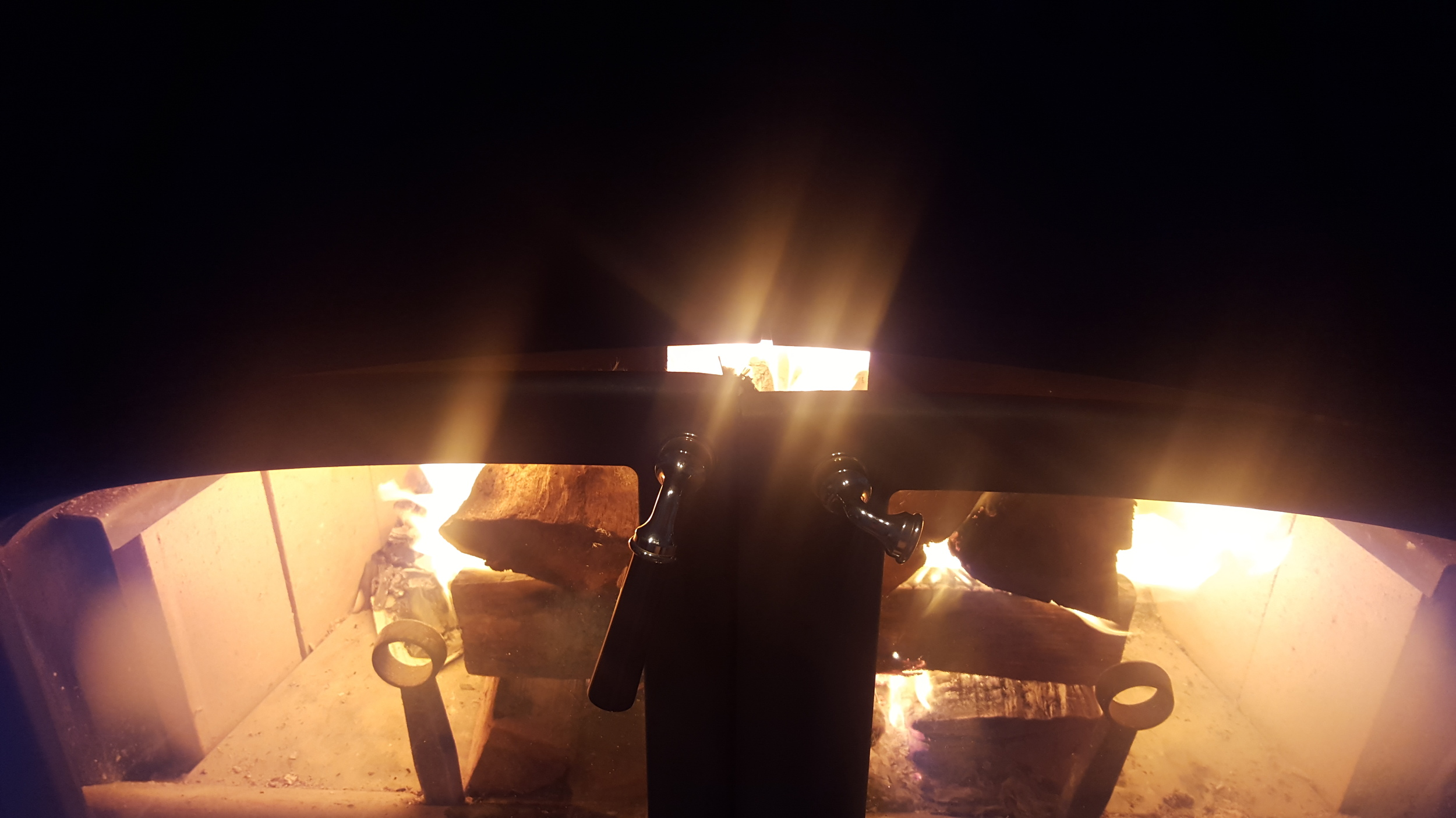 Doors closed partially allowing air to be drawn in by the fire itself accelerating the burn