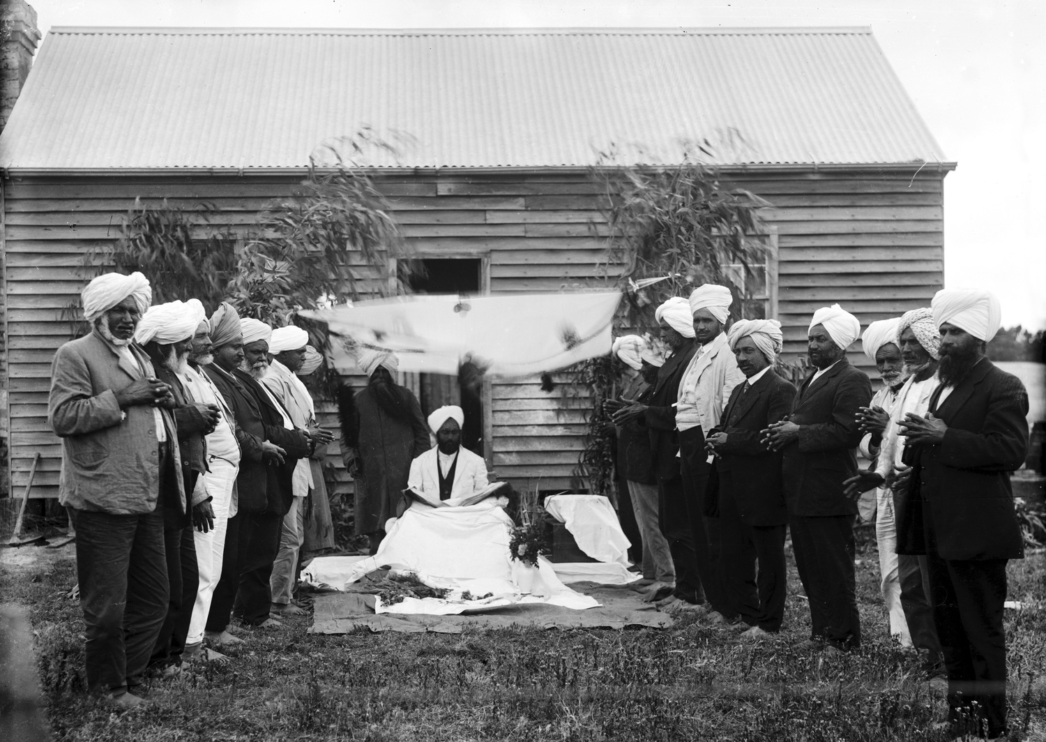 """Reference: """"A group of Indian men, possibly Sikhs, outside a timber cottage at Reef Hills near Benalla,"""" W. J. Howship collection, University of Melbourne Archives, 1988.0137.00704"""