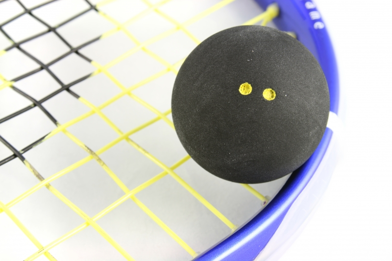 18518-squash-ball-on-racket.jpg