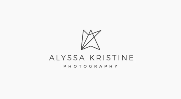 Another photographer's logo.  This one also includes a simple logo that plays off of the photographer's initials.