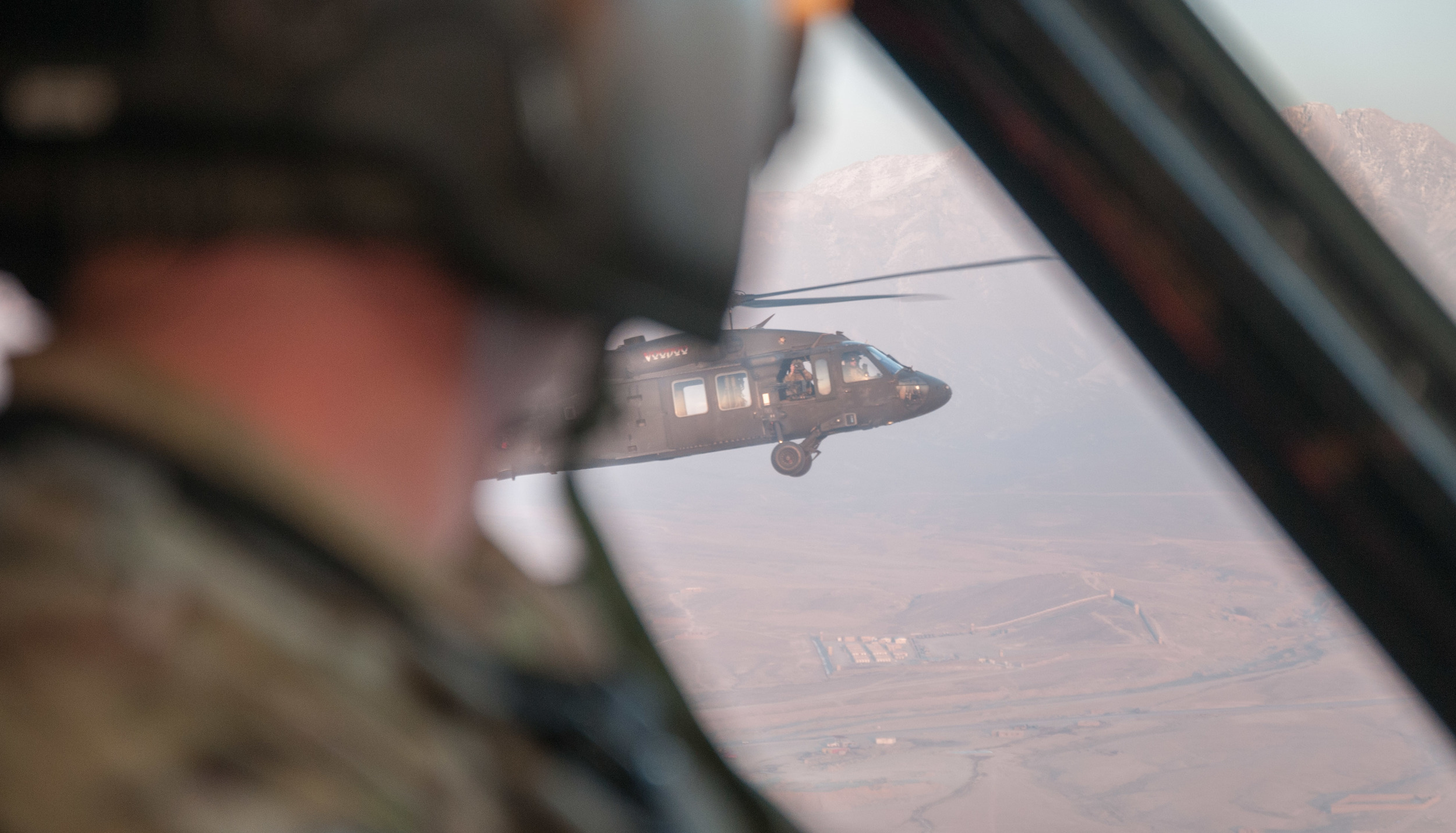 Steve's last flight in Afghanistan flies next to another UH-60 Blackhawk helicopter during a mission to Kabul.