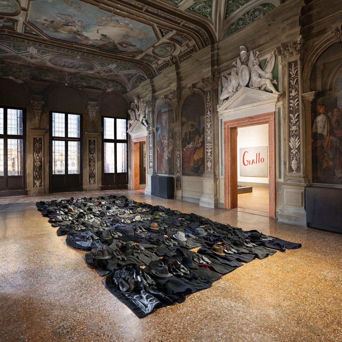 Jannis Kounellis Untitled, 2011 coats, hats, shoes  in the background  Jannis Kounellis Untitled (Giallo), 1965 oil on canvas