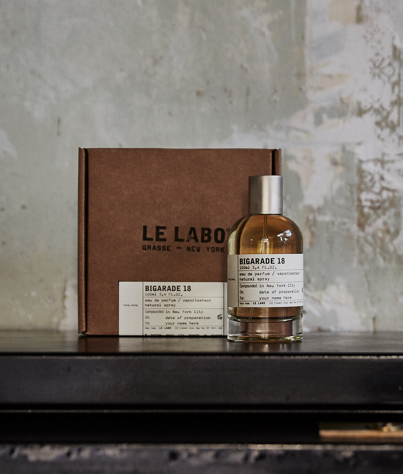 """BIGARADE 18,Hong Kong  City Exclusive   Le Labo _ """"Bigarade 18 is a schizophrenic perfume. It's very classical yet says something about you that really isn't. It's bright and very powerful, but you can't seem to breath enough of it in…And it's simple. You take the best bergamote and neroli petals there are and mix it with the best musks and synthetic ambergris out there, add a drop or two of woods et voila! The resulting tension is like a tug of war between the classical smell of citruses and the warm and transgressive hum of dark notes and woods where there is never a clear winner. Bigarade 18 is rigid yet comfortable, classic yet contemporary, bright yet long-lasting. We dedicate this perfume to Hong Kong, the fragrant bay of old and new, rich with memories for us of classic smells of white florals and citruses mixed with all the discovery and grandeur."""""""
