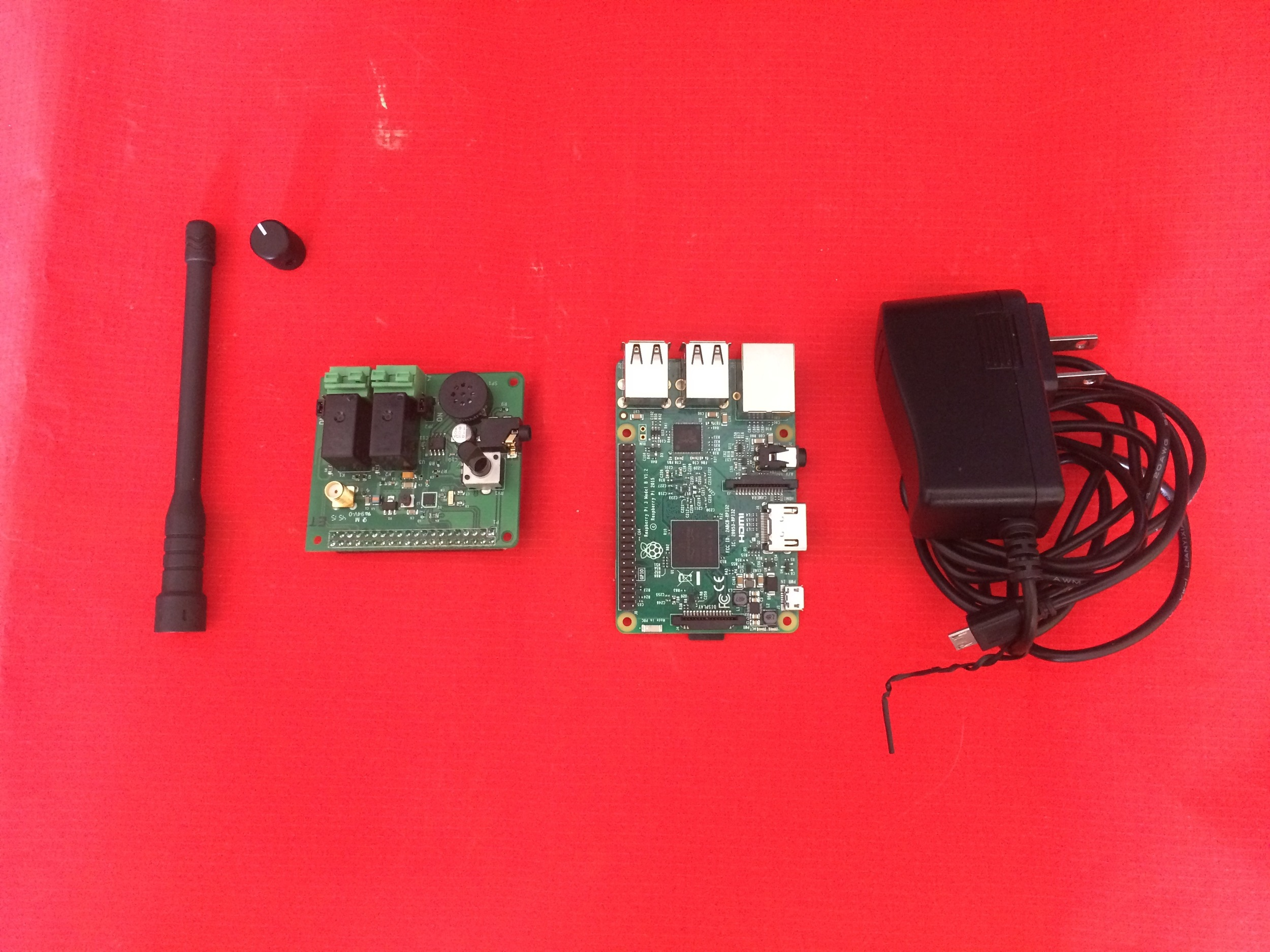 From Left to Right: SMA Wideband Antenna, Volume Knob, NWR Receiver/SAME Decoder and Power Adapter