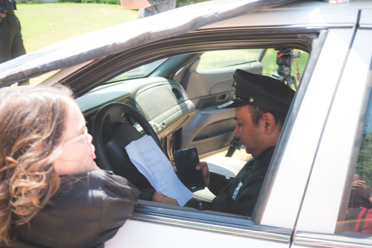 Double Duty - It's not unusual to be asked to do more than one job on a short film. In this case, I was asked to play a cop. I got to drive a police car and everything. (Photo provided by Matt Baber)