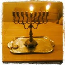 Hanukkiyah on first night of Hanukkah with shamash in center