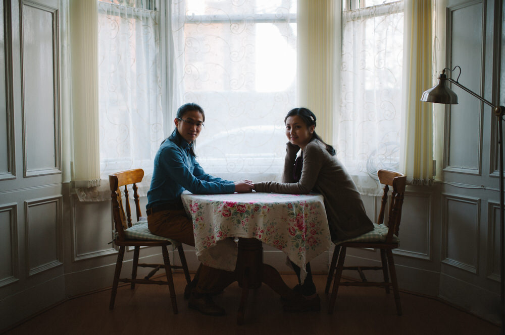 019-Couple-Wedding-Portrait-Boy-Girl-Sitting-at-table-holding-hands.jpg
