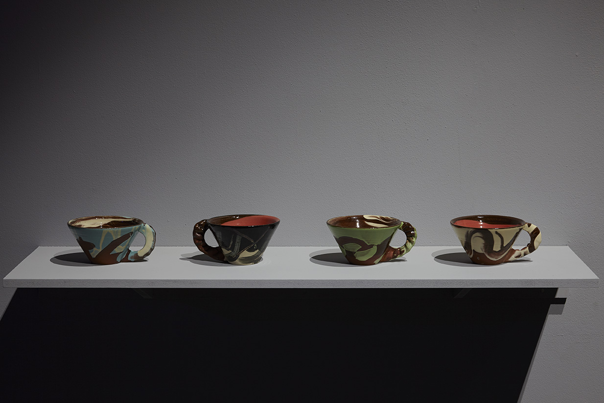 Untitled (Crimped-handle slipware mugs) , terracota, slips, transparent glaze, rim diameter 13cm approx.