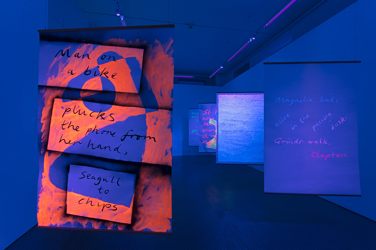 Installation view,  Black Light Poems , 2017, UV reactive acrylic and spray paint, ink on paper, oak beading, Exeter Phoenix, photo Jamie Woodley