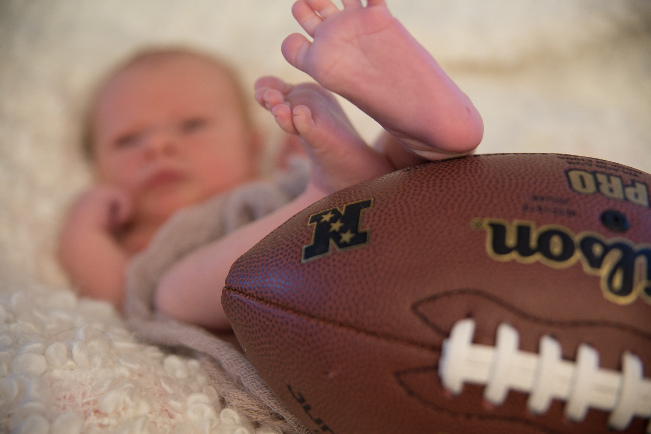 Maybe he'll be a football player like Daddy?