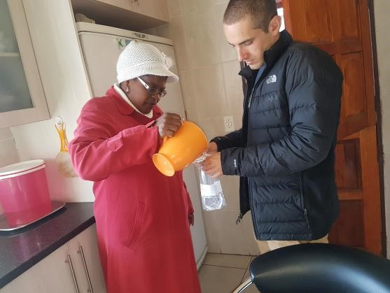 Thomas and Sinah collecting unfiltered water samples from a household in Dertig