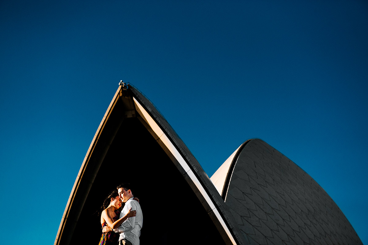A loving hug between a future bride and groom at the Sydney Opera House