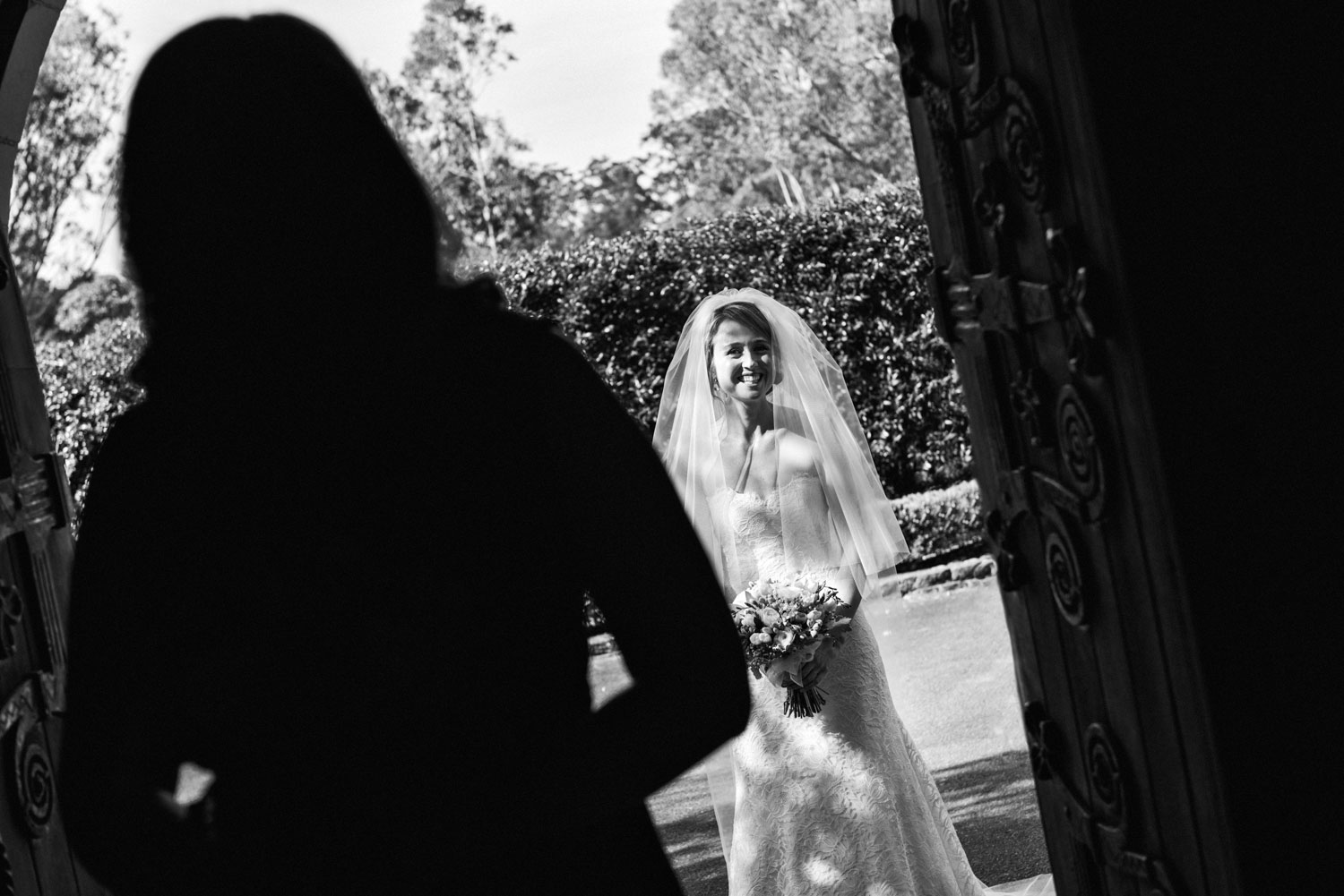 A delighted bride about to enter the King's School Chapel, Parramatta