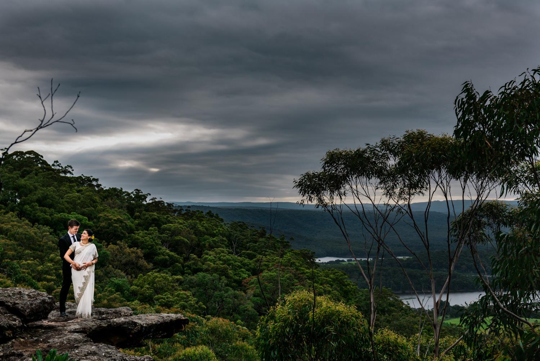 Couple pose with beautiful Shoalhaven views - Kangaroo Valley Bush Retreat wedding