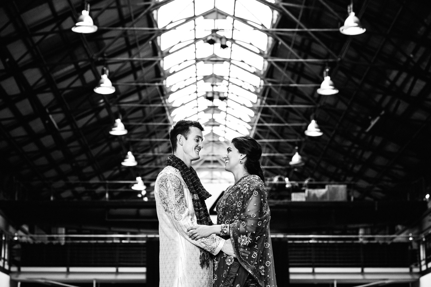 Married couple in traditional Indian wedding attire at Carriageworks