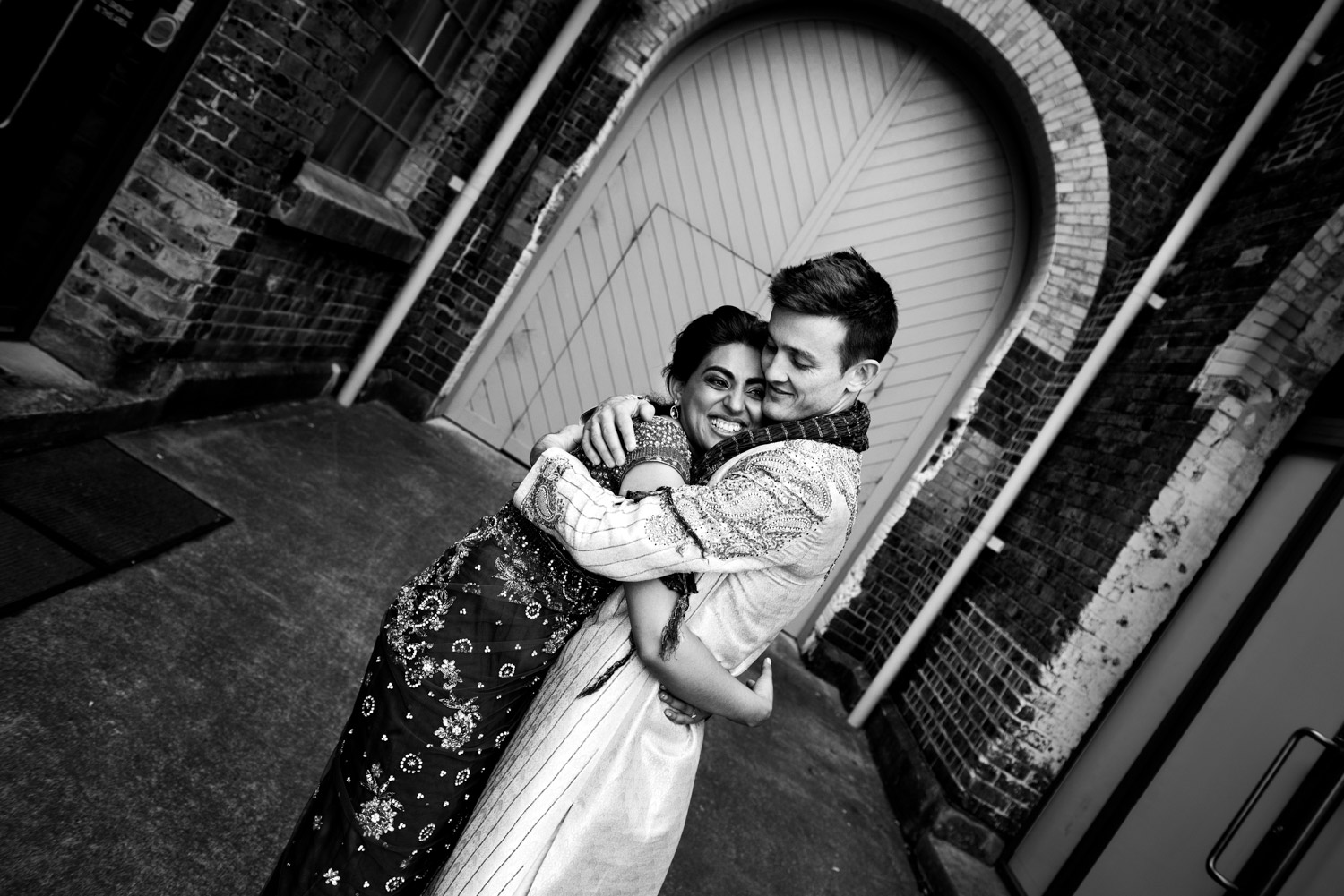 A husband and wife hug at Carriageworks