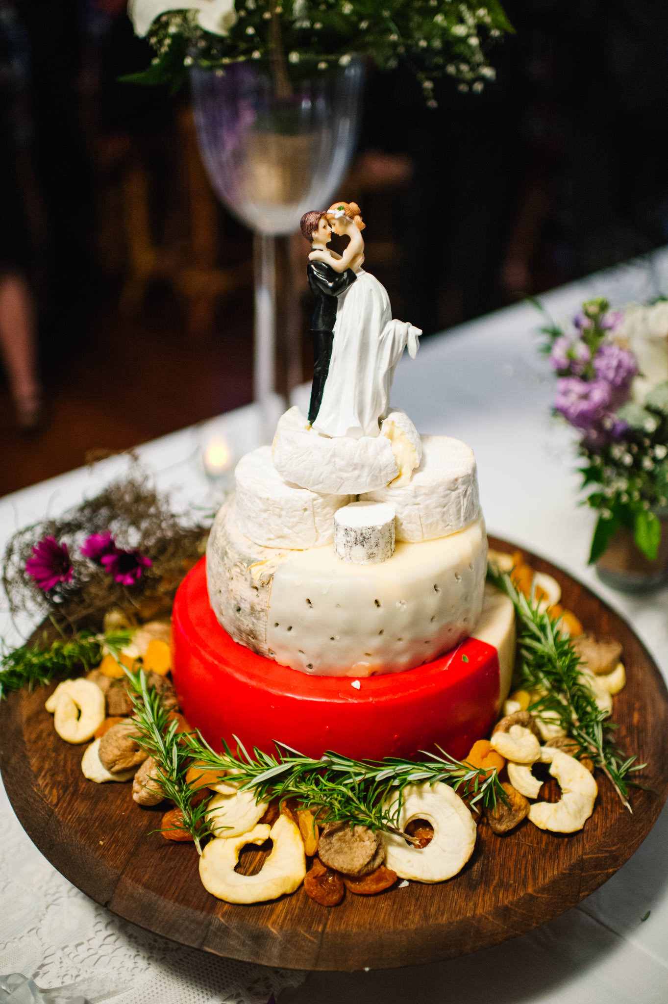 Photo of cheese cake with bride and groom topper