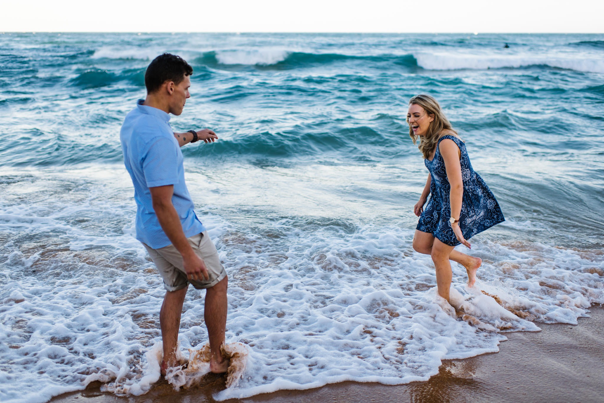 Couple playing in the waves
