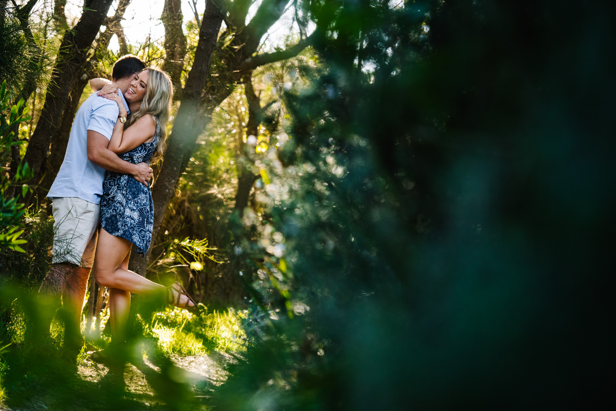 Engaged couple in forest scene