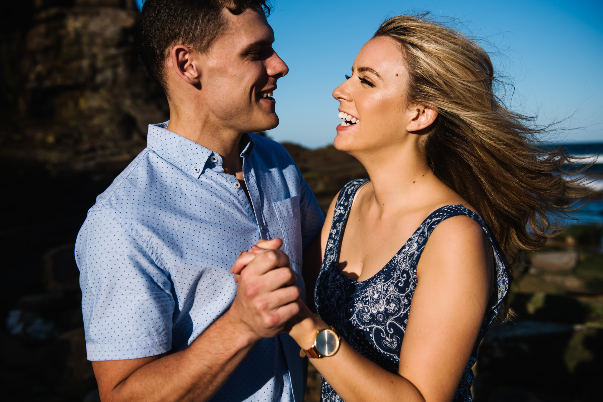 Happy engaged couple at beach