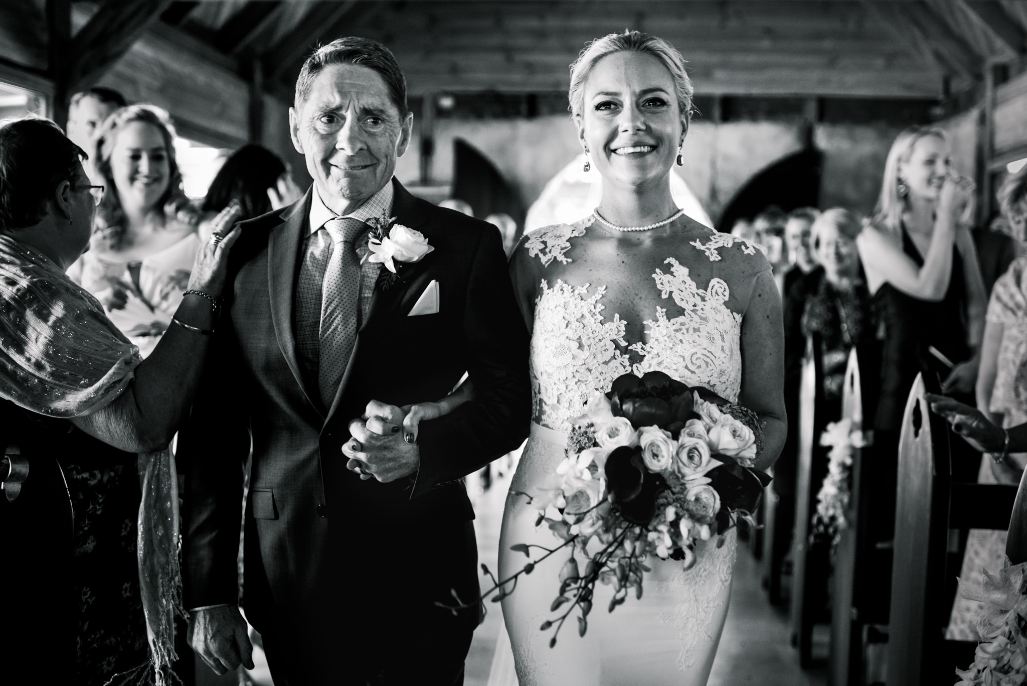 Emotional bride and father walk down aisle